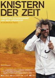 """Filmplakat für """"Knistern der Zeit - Christoph Schlingensief und sein Operndorf in Burkina Faso"""""""